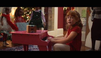 Smiling Amazon boxes are singing again in new holiday ad —will high shipping costs dull the mood?