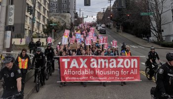 'Tax Amazon' protest draws 400 to company's HQ in dispute over plan to address homelessness crisis