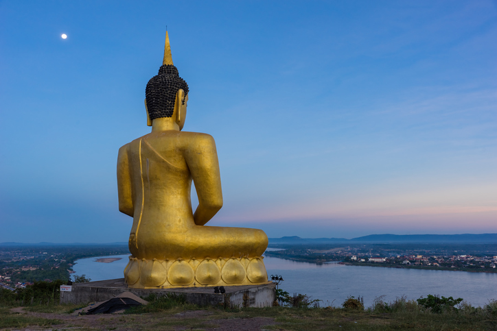 Buddha in blaze over the city at dawn