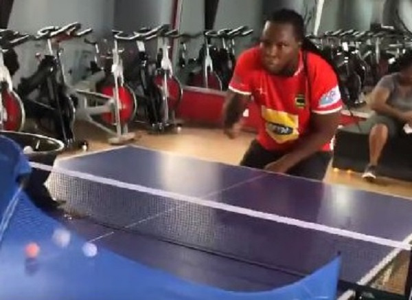 Rapper Ayigbe Edem spotted playing tennis in Asante Kotoko jersey