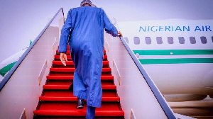 Buhari as he dey leave Abuja