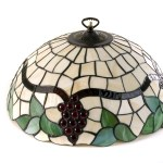 A Tiffany Style Glass Pendant Light Shade Having Leaf And Grape Decoration