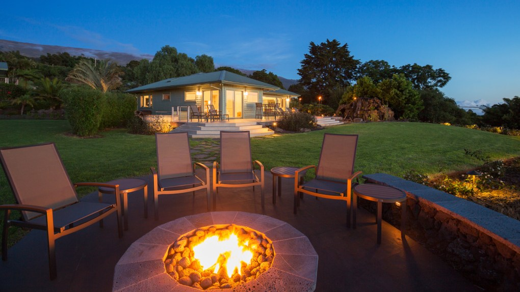 luxury backyard with landscaping and firepit
