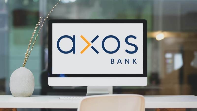 Axos Bank logo on computer monitor screen.