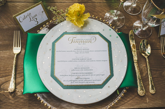 dotted plate and gold flatware