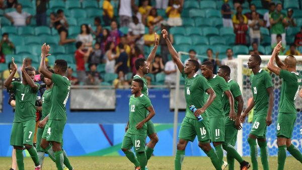 Nigeria's players celebrate after defeating Denmark in their Rio 2016 Olympic Games men's quarter-final football match Nigeria vs Denmark, at the Arena Fonte Nova Stadium in Salvador, Brazil on August 13, 2016.  NELSON ALMEIDA / AFP