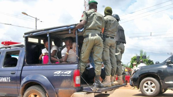 Security personnel taking away youths arrested for alleged violation of the law at Sokponba...yesterday