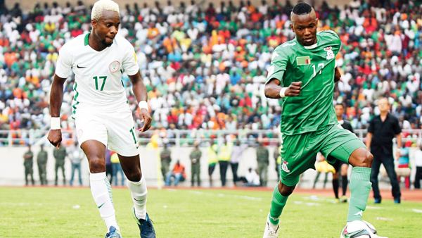 Zambia's Rainford Kalaba (right) vies with Nigeria's Ogenyi Onazi during the FIFA World Cup qualifier at the Levy Mwanawasa Satdium in Ndola…yesterday. PHOTO: AFP