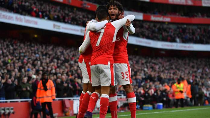 Arsenal's Chilean striker Alexis Sanchez celebrates with teammates after scoring the opening goal of the English Premier League football match between Arsenal and Bournemouth at the Emirates Stadium in London on November 27, 2016.  Ben STANSALL / AFP