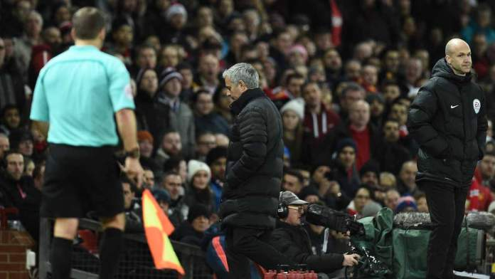 Manchester United's Portuguese manager Jose Mourinho (C) leaves the touchline after referee Jonathan Moss sent him to the stands during the English Premier League football match between Manchester United and West Ham United at Old Trafford in Manchester, north west England, on November 27, 2016.  Oli SCARFF / AFP