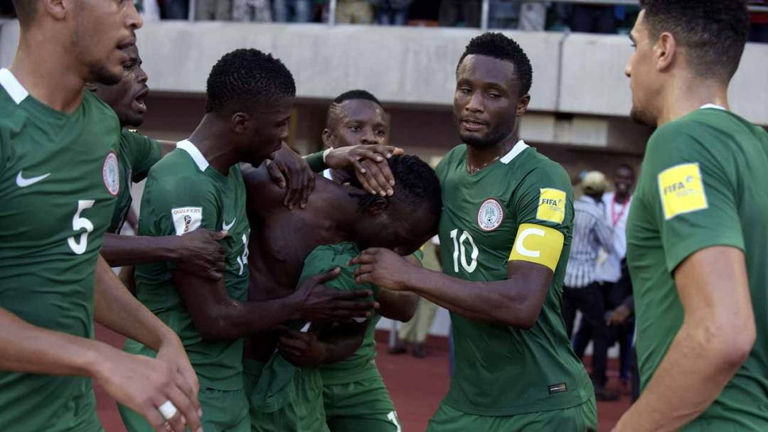 Nigeria's midfielder Victor Moses (C) celebrates with teammates after scoring a goal during the 2018 FIFA World Cup African zone group B qualifying football match between Nigeria and Algeria at the Akwa Ibom State Stadium in Uyo on November 12, 2016.  PIUS UTOMI EKPEI / AFP