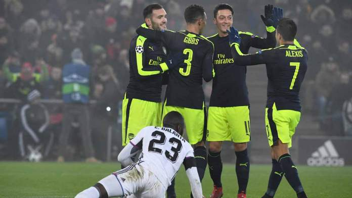 (From L- top) Arsenal's Spanish forward Lucas Perez celebrates after scoring a goal with his teammates Arsenal's English defender Kieran Gibbs, Arsenal's German midfielder Mesut Ozil and Arsenal's Chilean forward Alexis Sanchez, next to Basel's Colombian defender Eder Balanta during the UEFA Champions league Group A football match between FC Basel 1893 and Arsenal FC on December 6, 2016 at the St Jakob Park stadium in Basel.  Patrick HERTZOG / AFP