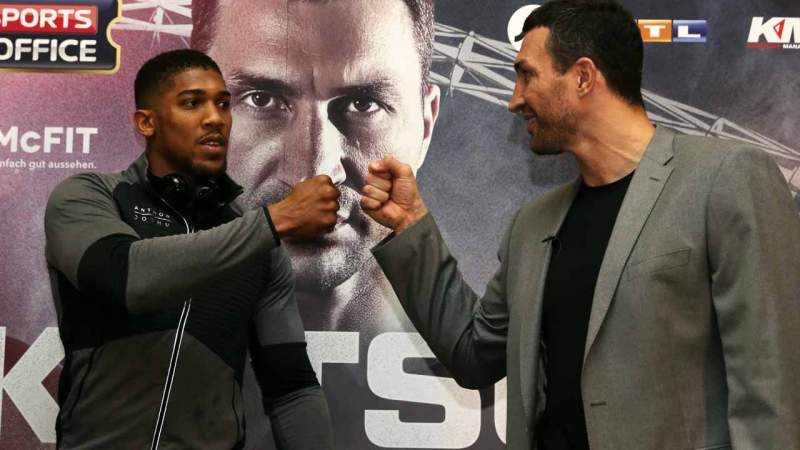 Britain's Anthony Joshua (L) and Ukraine's Wladimir Klitschko (R) take part in a press conference at Wembley Stadium in north west London on December 14, 2016. Ukraine's Wladimir Klitschko will fight Britain's Anthony Joshua on April 29, 2017 at Wembley Stadium in London Daniel LEAL-OLIVAS / AFP