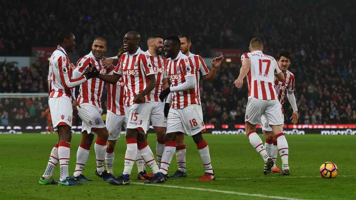Stoke players mob Stoke City's Welsh midfielder Joe Allen after he scored his team's second goal during the English Premier League football match between Stoke City and Leicester City at the Bet365 Stadium in Stoke-on-Trent, central England on December 17, 2016.  Paul ELLIS / AFP