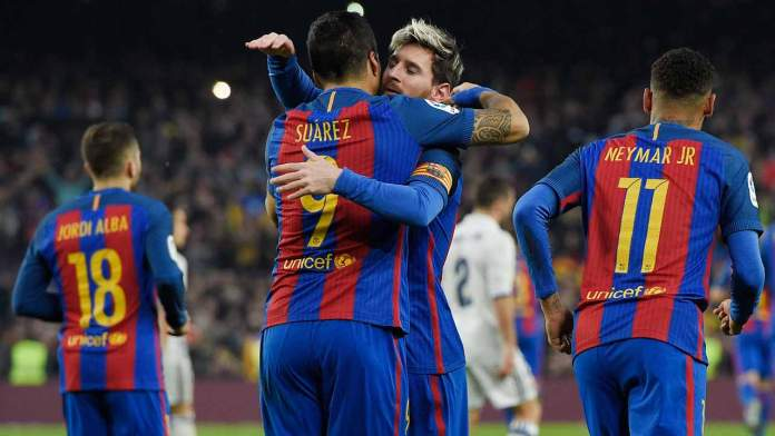 Barcelona's Uruguayan forward Luis Suarez (CL) celebrates with Barcelona's Argentinian forward Lionel Messi during the Spanish league football match FC Barcelona vs Real Madrid CF at the Camp Nou stadium in Barcelona on December 3, 2016.  LLUIS GENE / AFP
