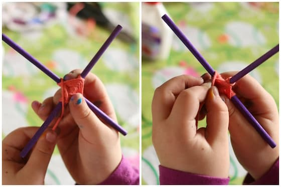 Tween craft 9 year old making God's Eye with craft sticks and orange yarn