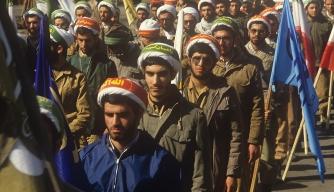 Iran clergymen march in Tehran during Iran-Iraq War