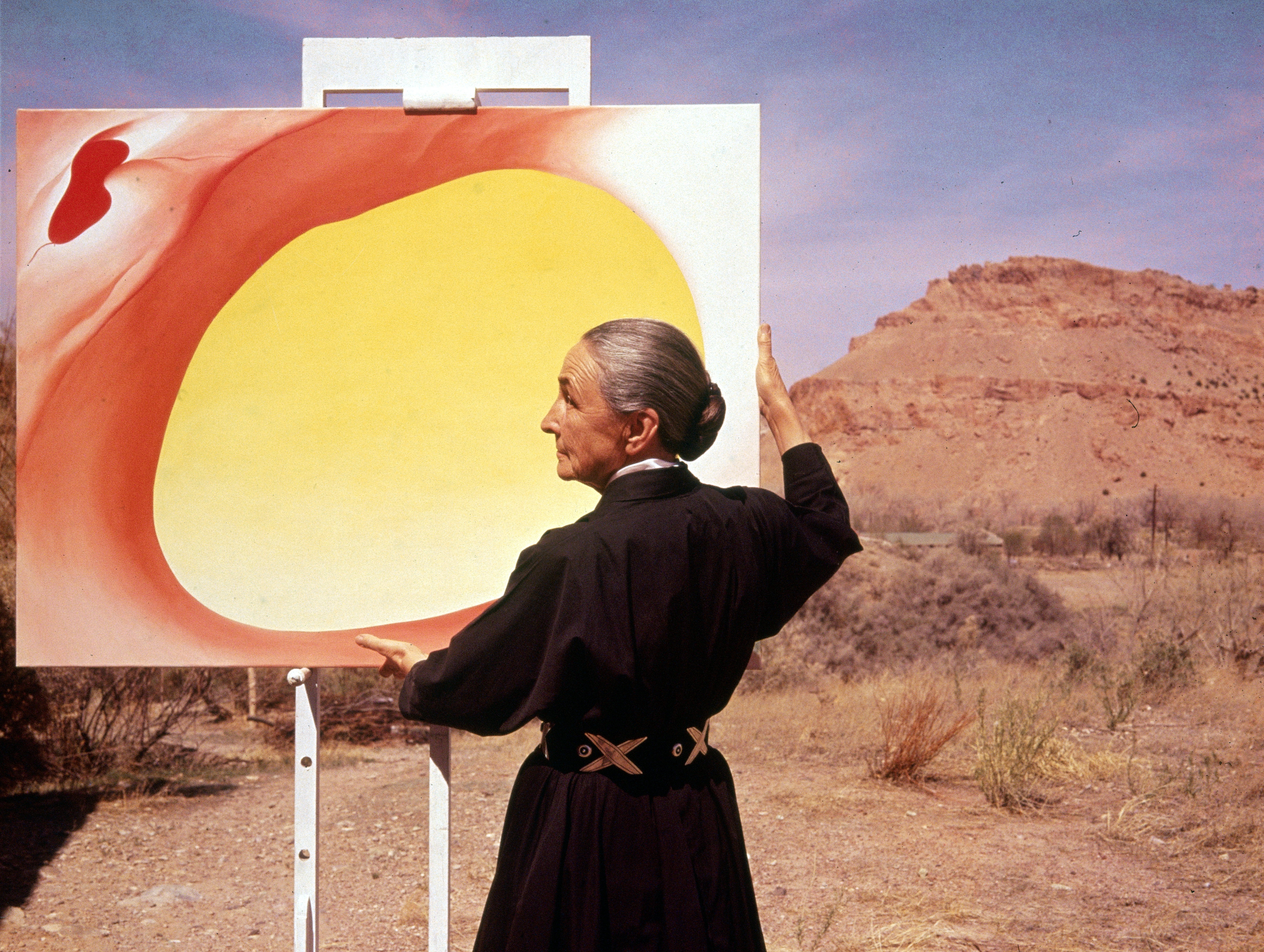 Georgia Okeeffe With Painting In Desert Nm