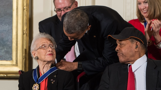 US President Barack Obama presents the Presidential Medal of Freedom to NASA mathematician and physicist Katherine Johnson at the White House. (Credit: NICHOLAS KAMM/AFP/Getty Images)