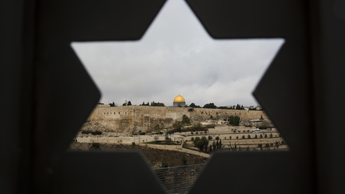 Jerusalem seen through a door with the shape of the star of David. U.S. officials say President Donald Trump will recognize Jerusalem as Israel's capital Wednesday, Dec. 6, and instruct the State Department to begin the multi-year process of moving the American embassy from Tel Aviv to the holy city. (Credit: Oded Balilty/AP Photo)