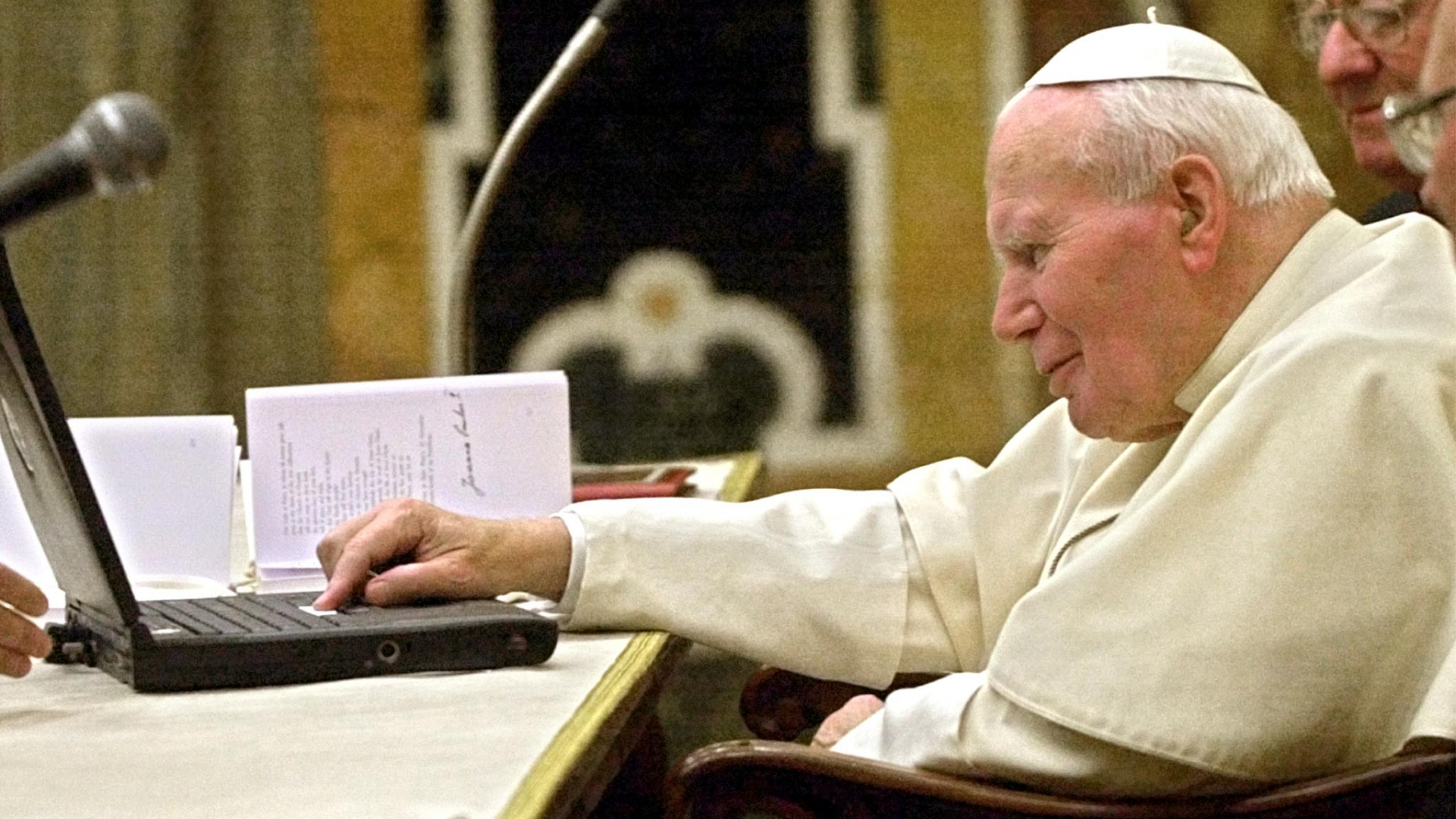 Pope John Paul II sending an e-mail at the Vatican, in his first message sent to the world directly over the Internet, apologizing to victims of sexual abuse by priests and other clergy, including nuns, in the developing world. (Credit: Massimo Sambucetti/AFP/Getty Images)