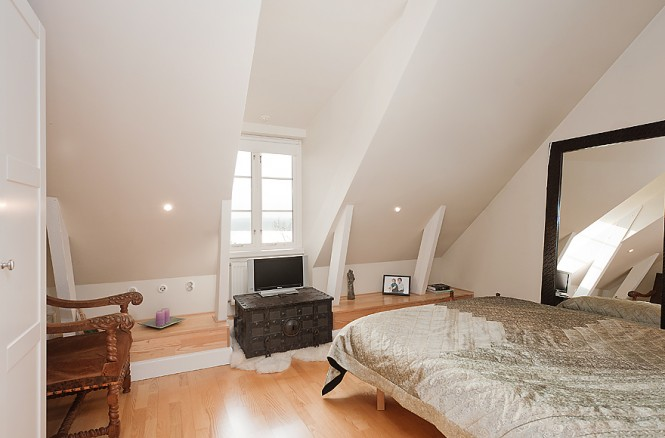 neutral white attic bedroom