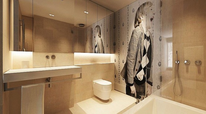 In this bathroom a piece of wall art takes center stage, creating a focal pointing the gentle scheme.