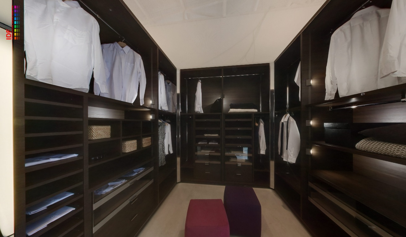 Fitted Mens Wardrobe In Rich Wood With Lighting Interior