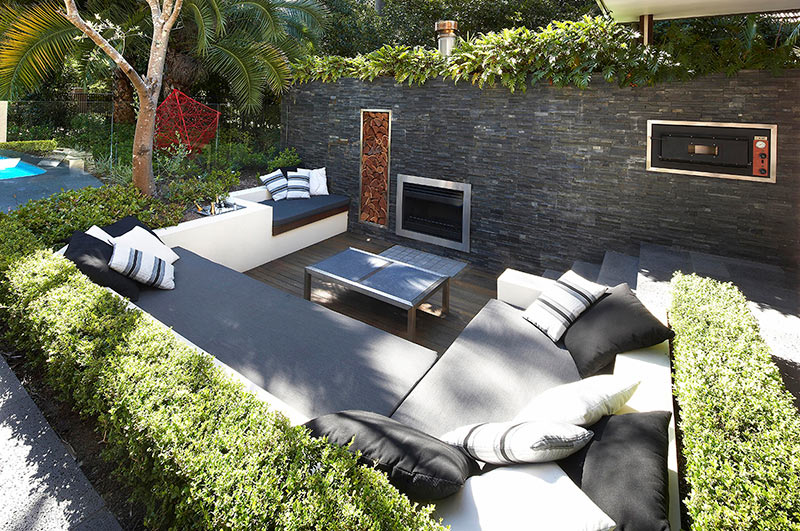 Outdoor Living with Sunken Lounge- hedges and stone wall ... on Backyard Lounge Area Ideas id=96320