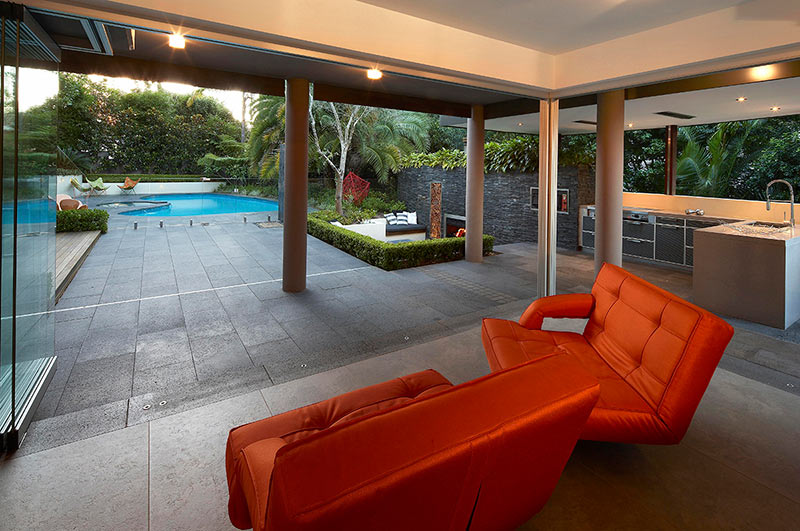 Outdoor Living with Sunken Lounge- orange seating lounges ... on Backyard Lounge Area Ideas id=88864