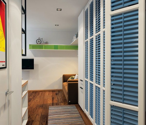Storage is a necessity, no matter how much room you have. By using these adorable blue shutters to disguise shelving, the designer brings color into the space and helps the room to feel bigger.