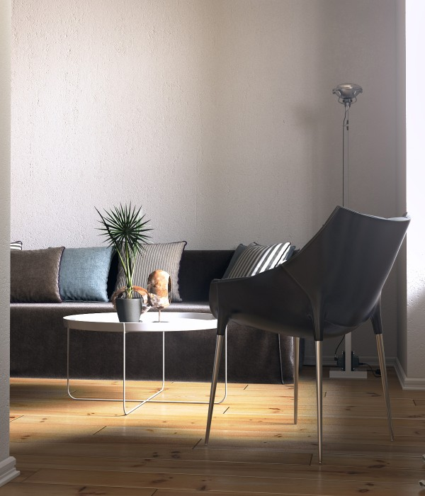 In the living area, the use of clean, simple furnishings like this amazing leather chair and a coffee table on spindly chrome legs, makes the space feel very open.