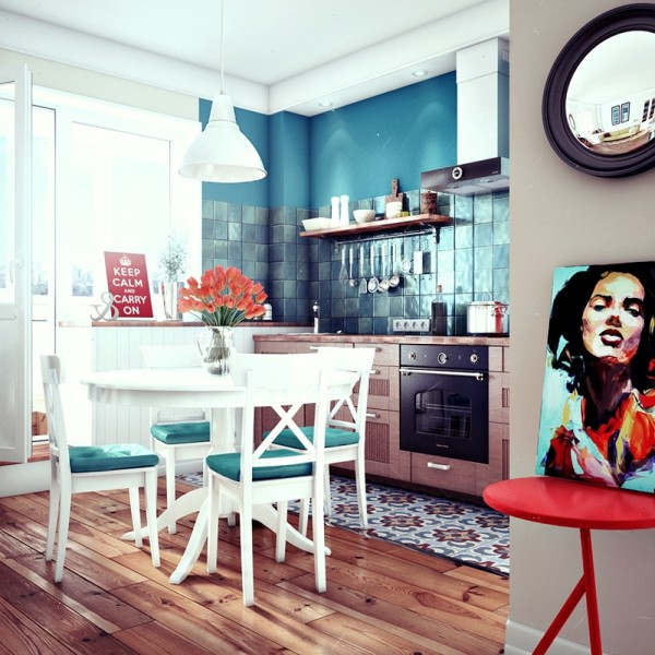 Teal in the kitchen and a small dining table are beautiful and welcoming.