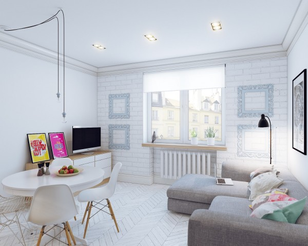 Despite the overwhelming white palette, we still see splashes of color in the sofa's throw pillows and some graphic art.