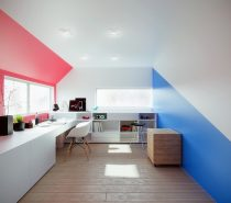 Clear, white ceilings allow bubblegum red and ocean blue to dramatically border this minimalistic office design.