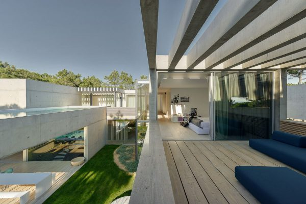 The Main Pool Area Criss Crosses Swimmers In Large Concrete Beam  Reflections And A Dazzling Array Of Thin Rafter Shadows, Visible In  Patterns On The Deck.