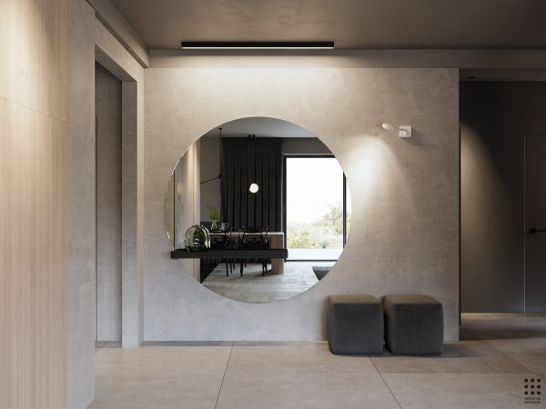 In The Hallway, An Enormous Circular Mirror Just About Covers All Of One  Wall. Just Enough Room Is Left At One End To Situate A Couple Of Cube  Stools.