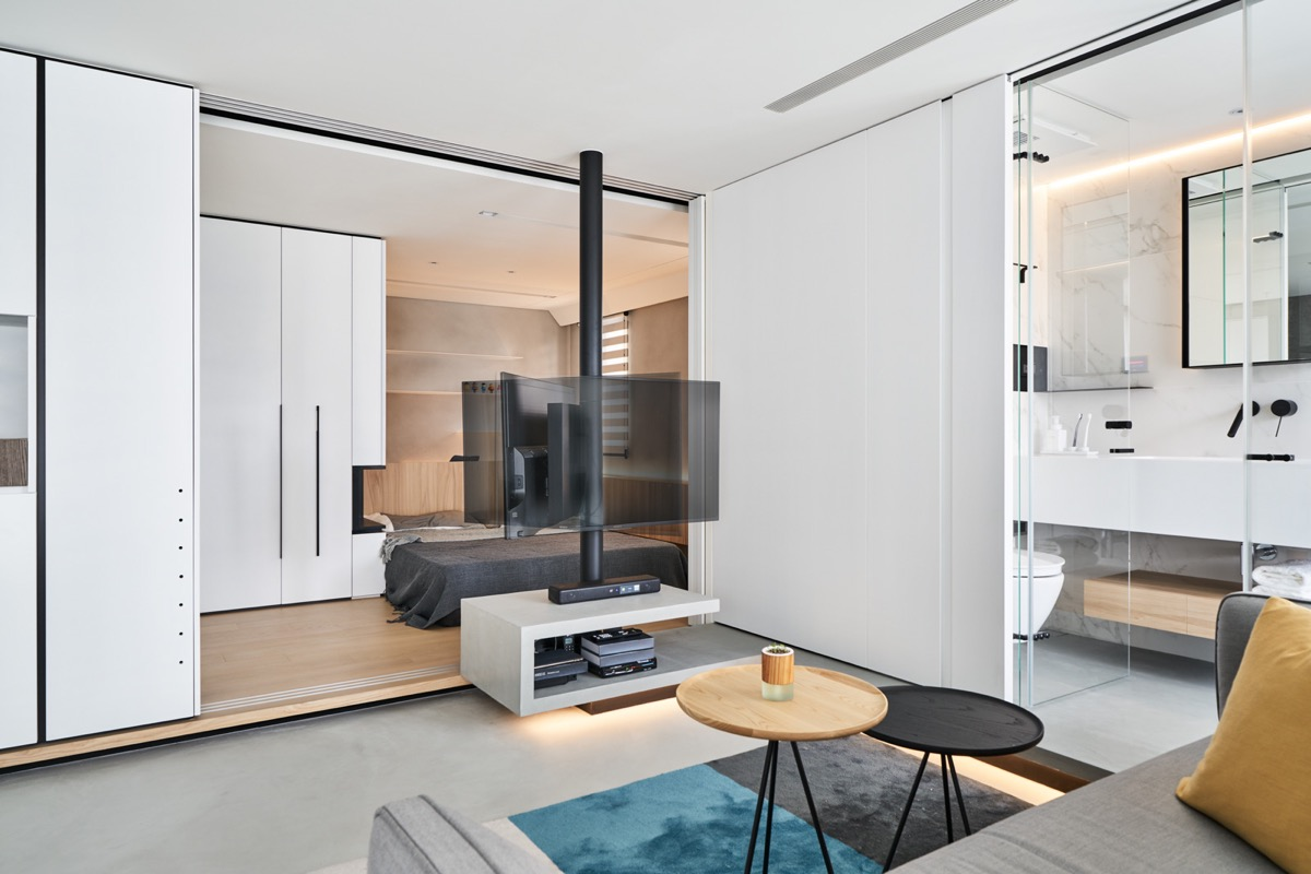The TV Unit Is Formed Using A Folding Concept, Which At Its Open Side Runs  Into The Platform Floor Of The Bathroom.