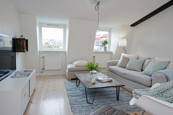 An Apartment Which Shows Us That White Walls Can Also Be Cozy