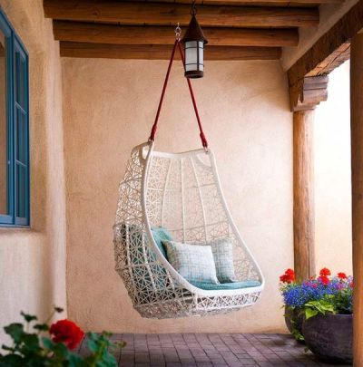 Meditation Room Decor White Wicker Hanging Chair with Blue Cushion and Red Rope Outdoor Patio