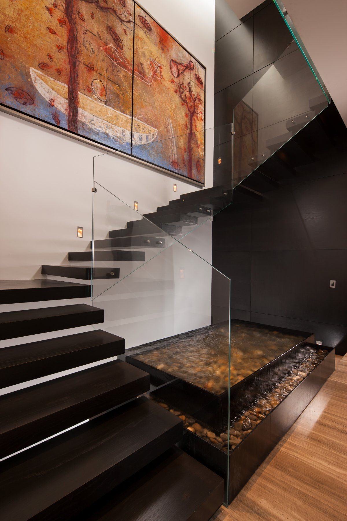 20 Glass Staircase Wall Designs With A Graceful Impact On The | Duplex Stairs Wall Design | Middle Room Interior Design | Attractive | Staircase Wall Panel | Living Room Layout | Bungalow Duplex Indian