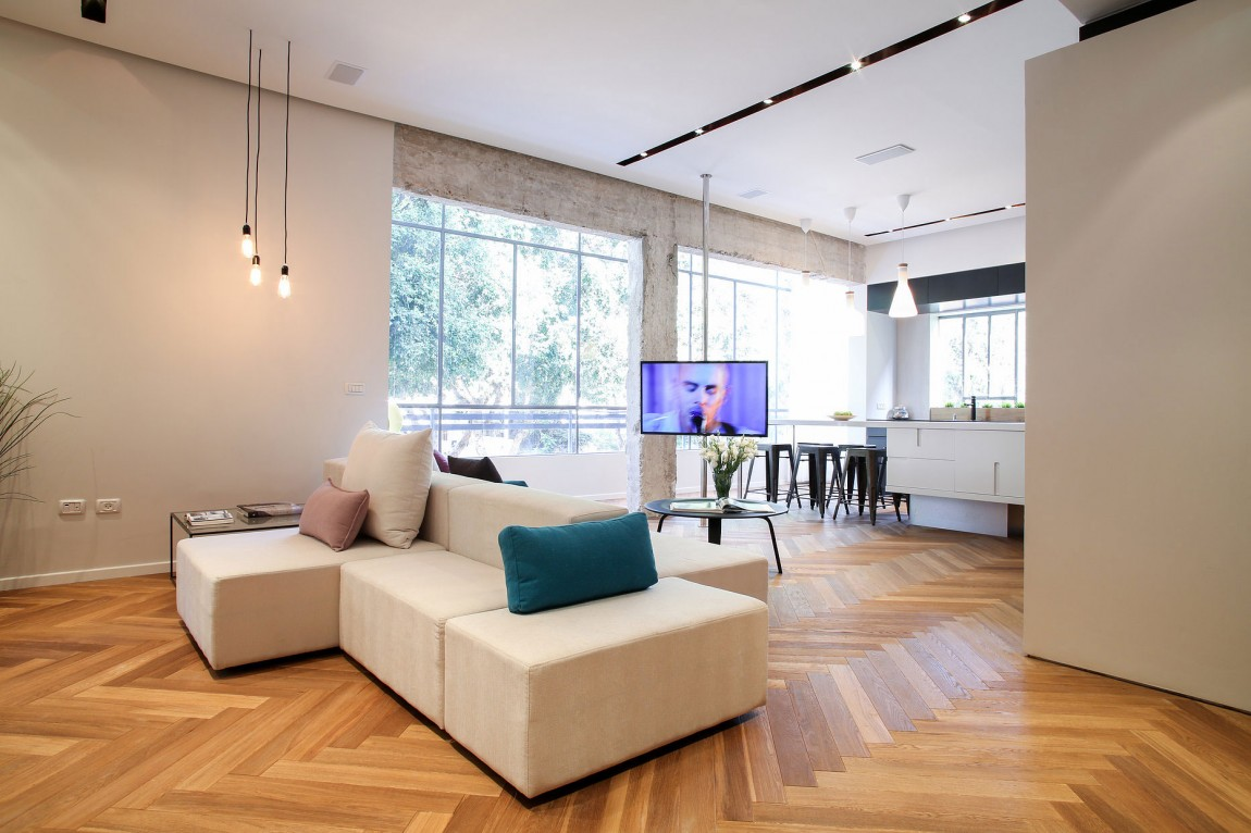 Herringbone Floors And Concrete Columns Linked By Modern