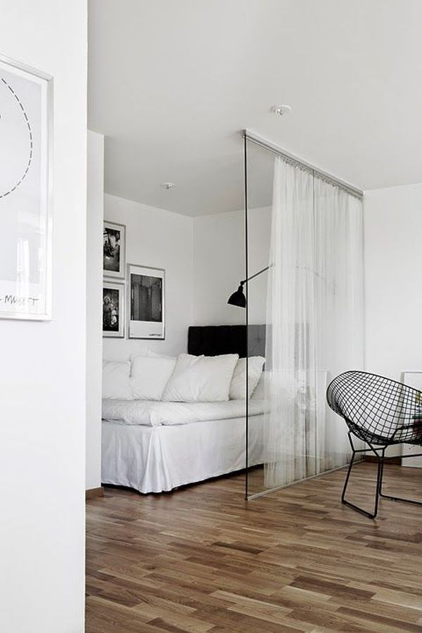 wall dividers studio apartment ideas glass panel separator see through windows white curtain bedding black and