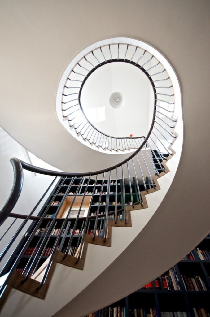 Spiral Staircase With A Beautiful Bookcase Wall1 Home