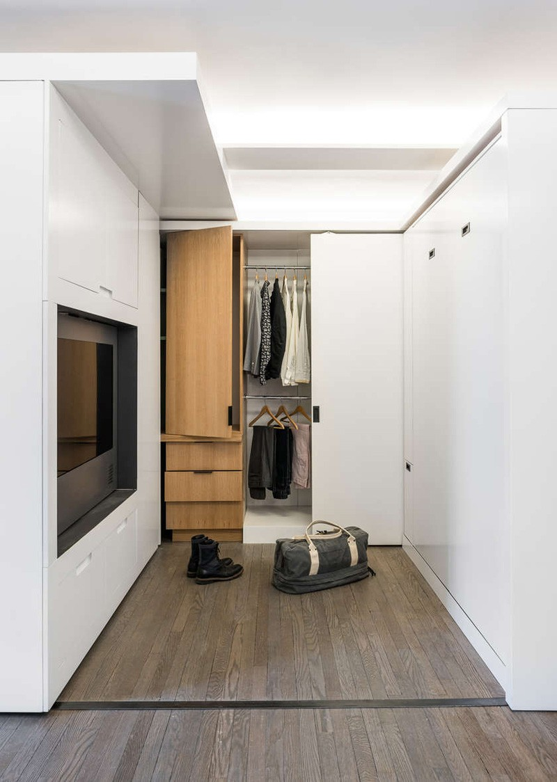 Small Apartment Utilizes A Sliding Wall To Hide Its Functions