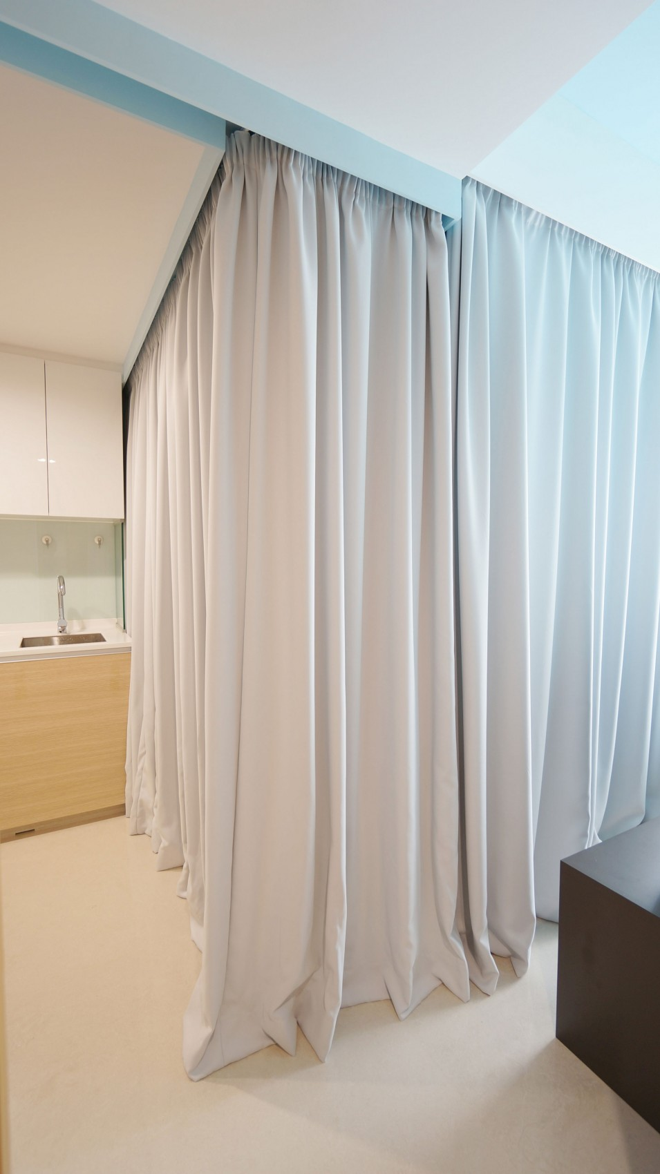 Tiny Apartment Uses Fabric Curtains To Divide Its Spaces