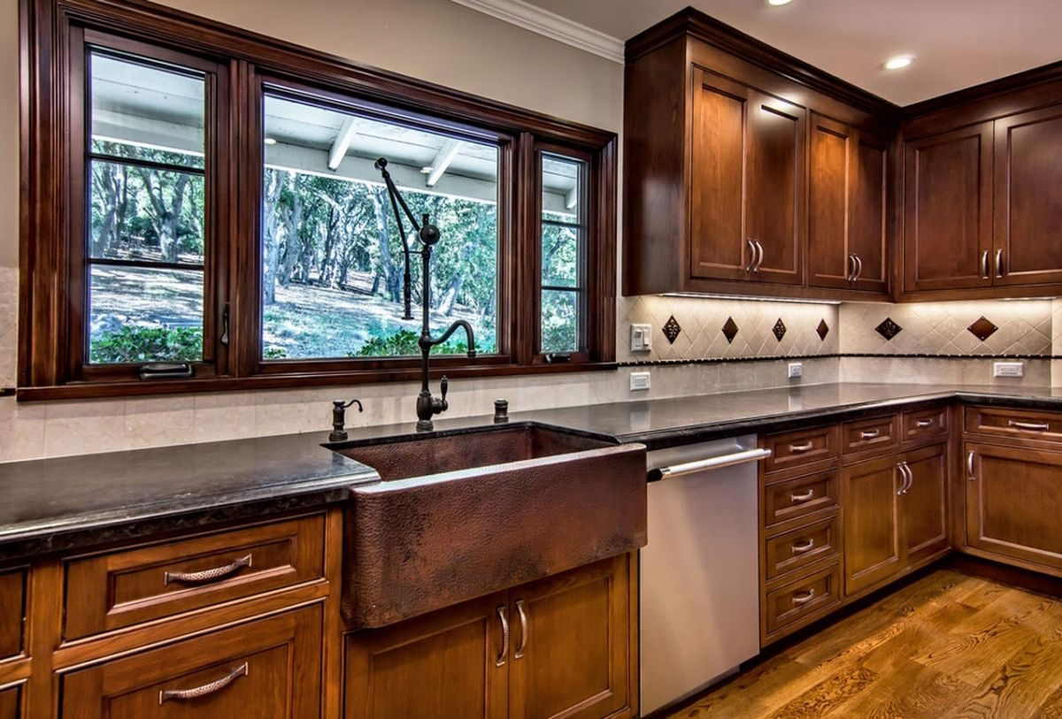 a copper farmhouse sink to a kitchen
