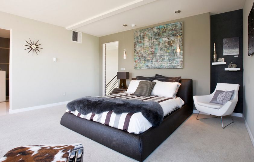 Modern leather bed with painting over it