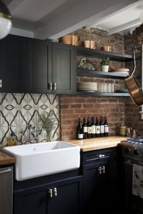 20 Black Kitchens That Will Change Your Mind About Using Dark Colors Black Farmhouse Kitchen With Exposed Brick Backsplash