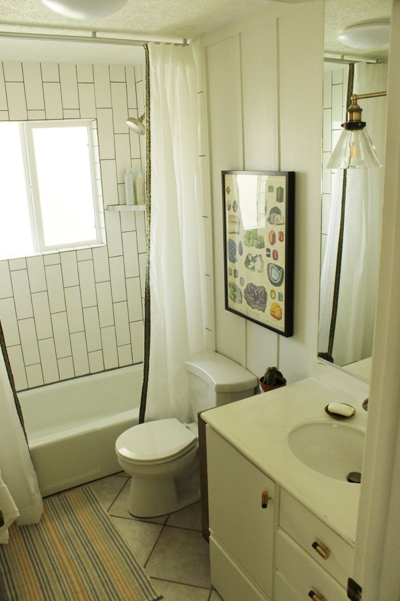 Bathroom makeover with curtain and art